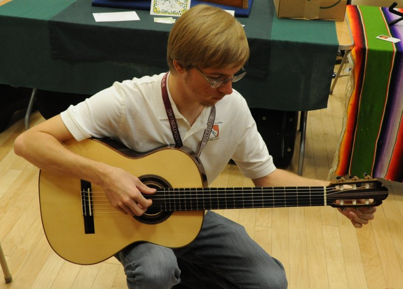 Aaron Tuning His Latest Spruce Guitar at the GFA Convention